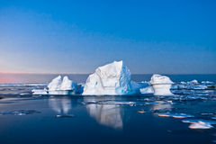 Antarctic icebergs. Summer night in Antarctica.Icebergs floating in the moonlight Royalty Free Stock Images