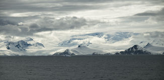 Antarctic Landscape. The Antarctic coastline and moutain ranges as seen from the sea around the peninsula Royalty Free Stock Photos