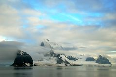 Antarctic Landscape. Landscape in Antarctica showing mountains in cloud stock photo
