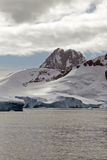 Antarctic landscape. Mountanous Antarctic landscape with sky and ocean royalty free stock image