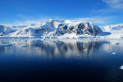 Antarctic landscape, blue skies. Blue sea and snowy antarctic mountains Royalty Free Stock Photos