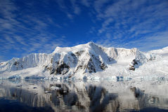 Antarctic landscape. Reflections of antarctica with sunny skies Stock Images