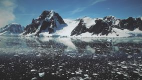 Antarctic Lemaire channel water surface drone view stock video footage