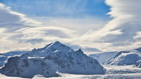 Antarctic Nature: snow-capped mountains against dramatic sky stock video footage