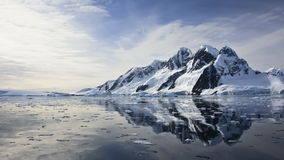 Antarctic Nature: snow-capped mountains reflected in ocean stock video