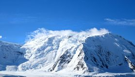 Antarctic ocean, Antarctica. Glacier Snow Covered Mountain. Dramatic blue Sky. Background Stock Image