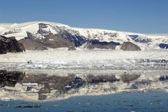 Antarctic Peninsula near Larsen A. Antarctic glacier remains of the melting Larsen A iceshelf in front of reflecting mountains of the peninsula. Picture was Stock Image