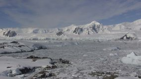 Antarctic Peninsula and the ocean along it covered with ice and snow stock footage