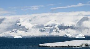 Antarctic Peninsula Scenery. Scenery along the coast of the Antarctic Peninsula bathed in sunlight Stock Photos
