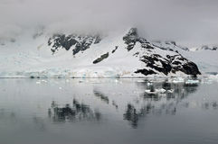 Antarctic reflection. Mountanous Antarctic landscape reflected in the icy waters royalty free stock photo