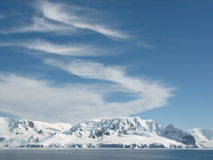 Antarctic summer skies. Fleece clouds in the antarctic summer skies are making a peaceful image in the otherwise hostile invironment royalty free stock image