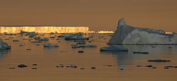 Antarctic sunset mood. With different icebergs Stock Photos