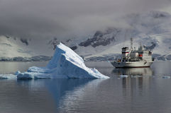 Antarctic tourism. A converted Russian icebreaker now used for tourism in the Antarctic. The vessel is shown among the icebergs in Paradise Bay on the Antarctic Royalty Free Stock Photography
