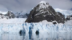 Antarctic view of ice caves and reflections royalty free stock photo
