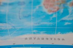 Antarctica in close up on the map. Focus on the name of country. Vignetting effect.  royalty free stock image