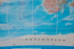 Antarctica in close up on the map. Focus on the name of country. Vignetting effect.  royalty free stock photos