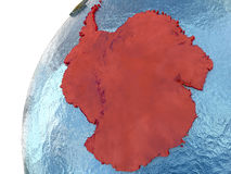 Antarctica on Earth. Antarctica highlighted in red with surrounding region. 3D illustration with highly detailed realistic planet surface and reflective ocean stock illustration