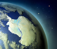 Antarctica from Earths orbit. Antarctica on planet Earth with glowing atmosphere lit by evening sun. 3D illustration with detailed planet surface. Elements of royalty free illustration