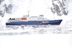 Antarctica Expedition Ship in Icy Waters. Ice hardened ship that can take about 125 passengers on expeditions to visit the Antarctic Peninsula Stock Images