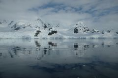 Antarctica glacial mountains reflecting in the mirror bay stock photo