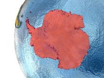 Antarctica on globe. Antarctica in red on globe with reflective ocean waters. 3D illustration with highly detailed planet surface. Elements of this image stock illustration