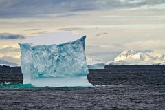 Antarctica - Iceberg Floating In The Southern Ocean. Antarctica - Non-Tabular Iceberg Floating In The Southern Ocean - Dramatic Landscape - Horizon Over Water Stock Photo