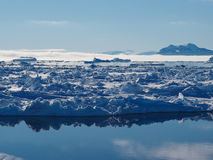Antarctica iceberg and ice floe landscape. Antarctica blue iceberg landscape ocean mirror reflection royalty free stock photography