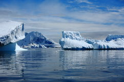 Antarctica, icebergs. Antarctica, blue icebergs with clouds in sunny day Stock Photo