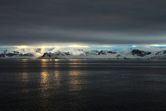 Antarctica landscape, icebergs, mountains and ocean at sunrise. Antarctica Royalty Free Stock Image