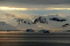 Antarctica landscape, icebergs, mountains and ocean at sunrise Stock Photo