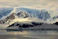 Antarctica landscape, icebergs, mountains and ocean at sunrise Stock Photos