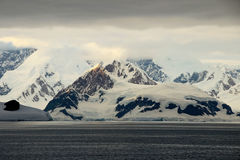 Antarctica landscape, icebergs, mountains and ocean at sunrise Royalty Free Stock Photography