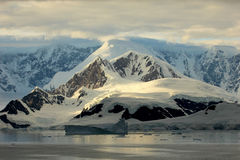 Antarctica landscape, icebergs, mountains and ocean at sunrise Royalty Free Stock Image