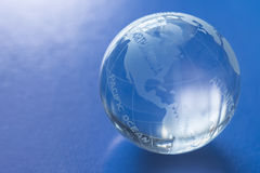 Globe. Glass globe with blue background Royalty Free Stock Images