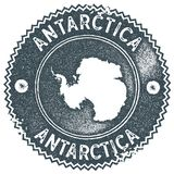 Antarctica map vintage stamp. Retro style handmade label, badge or element for travel souvenirs. Dark blue rubber stamp with country map silhouette. Vector stock illustration