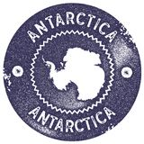 Antarctica map vintage stamp. Retro style handmade label, badge or element for travel souvenirs. Deep purple rubber stamp with country map silhouette. Vector royalty free illustration