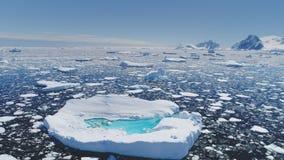Antarctica melting blue water iceberg aerial view