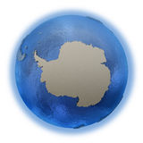 Antarctica on model of planet Earth. Antarctica on 3D model of blue Earth with embossed countries and blue ocean. 3D illustration on white background stock illustration