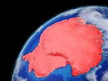 Antarctica on model of planet Earth with very detailed planet surface and clouds. Continent highlighted in red. 3D illustration. stock illustration