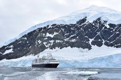 Antarctica an amazing landscape with an expedition cruise ship stock photos