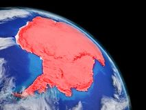 Antarctica in red from space. Antarctica from space. Planet Earth with extremely high detail of planet surface and clouds. Continent highlighted in red. 3D stock illustration
