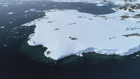 Antarctica snow covered peninsula aerial top view. Arctic Coast Wild Winter Extreme Nature Landscape. Polar Frozen Island Shore Seascape Drone Flight Footage stock video footage