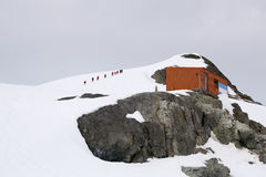 Antarctica. Some tourist hiking in Antarctica Stock Photo