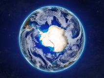 Antarctica from space on realistic model of planet Earth with country borders and detailed planet surface and clouds. 3D royalty free illustration