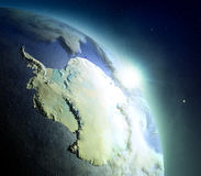 Antarctica from space during sunrise. Sunrise above Antarctica. Concept of new beginning, hope, light. 3D illustration with detailed planet surface, atmosphere Royalty Free Stock Photography