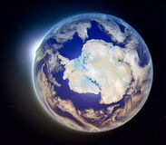 Antarctica from space at sunset. Antarctica with sun setting below the horizon of planet Earth in space. 3D illustration with detailed planet surface. Elements royalty free illustration