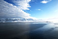 Antarctica on a Sunny day- Antarctic Peninsula - Huge Icebergs and blue sky. Cloud shadows stock images