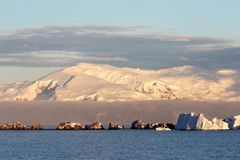 Antarctica on a Sunny day- Antarctic Peninsula - Sunset light and blue sky royalty free stock images