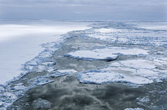 Antarctica Weddell Sea Ice floe clouds reflecting in water Royalty Free Stock Images