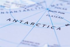Antartica on a map. Close up of a world map with the word Antartica in focus Stock Photography